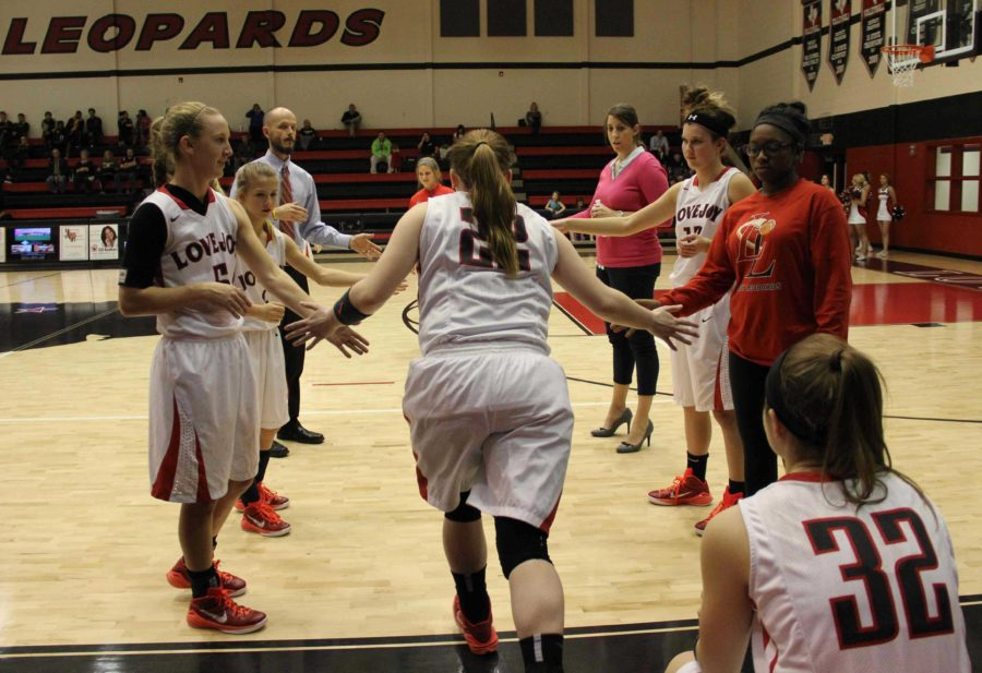 Senior player #22 Samantha Odom is introduced and runs through a tunnel made by her fellow teammates.