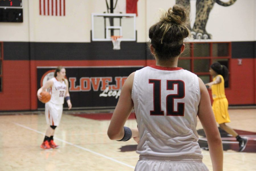 Junior Tate Thompson, #12, scored 3 points for the Lady Leopards in the third quarter against Denison with 0 fouls.