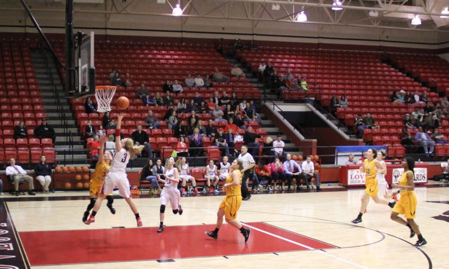 Bringing the score to 49-32, Paige Eberhart makes another lay-up in the fourth quarter.