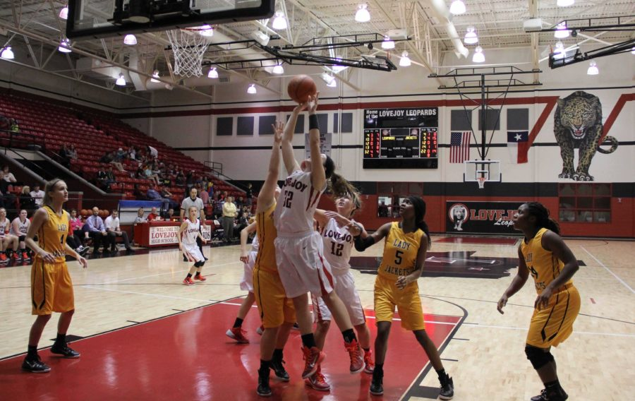 Sophomore Allison Hubble, player #32, brings the score 54-44 with less than a minute left in the fourth quarter.