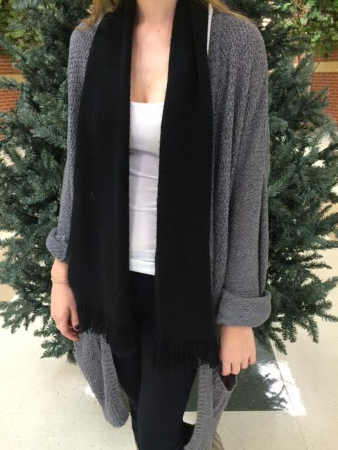 Students wear lazy scarves in anticipation of upcoming winter fashions.