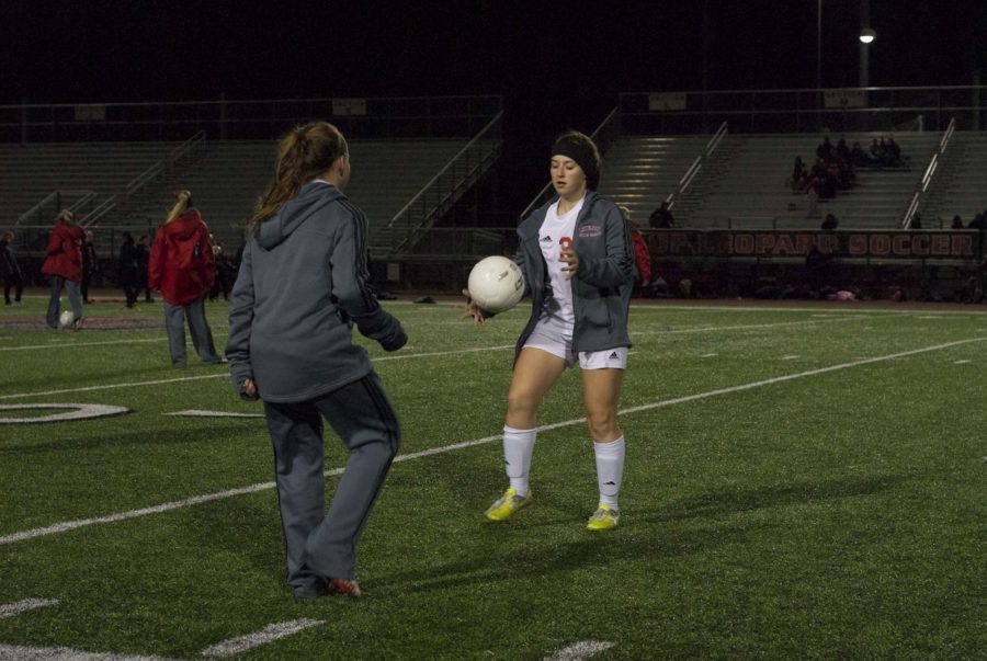 Girls Soccer Captain, Senior Morgan Hykin, warms up before a game against McKinney North.