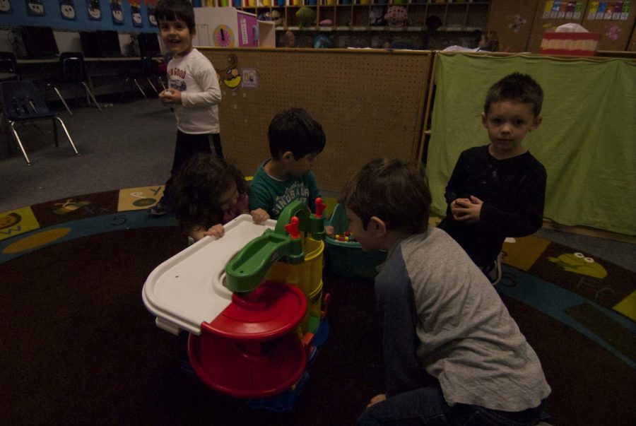 Some teachers' children spend their afternoons at Little Leopards at Hart Elementary. While there they play with other children.