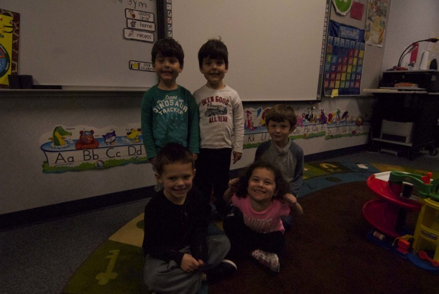 Some of the The Little Leopards got together for a group picture after playing with their toys.