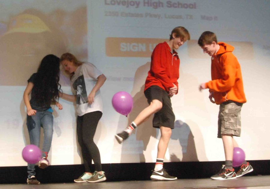 To energize the crowd and get students excited about Relay For life, students are brought up to to the stage and tried to pop balloons tied at their opponents ankles.