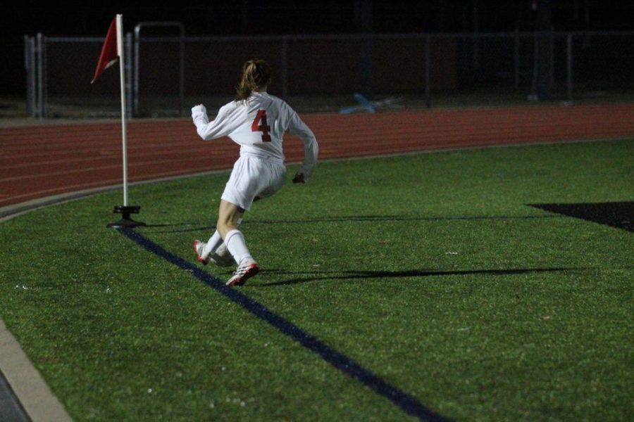 Morgan Hykin, a defender and one of the team captains chases down a ball, preventing it from going out of bounds, which would give Prosper possession in scoring position.