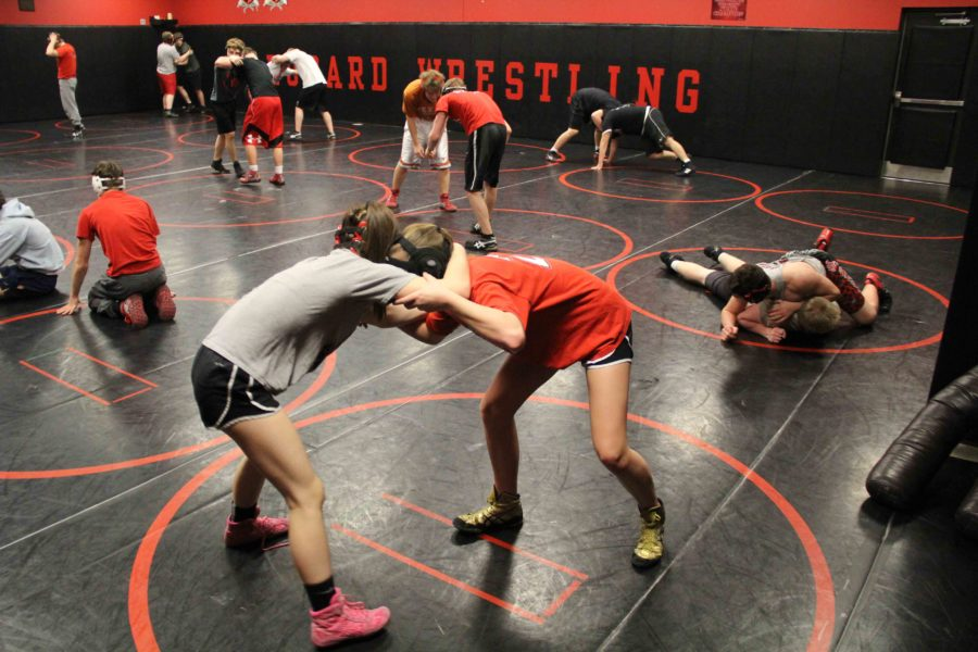 Both Abby Eaton and Julie Alyn begin in the neutral position, the starting position in which you stand face to face, and immediately Eaton has the upper-hand, wrapping her arms around Alyns neck.