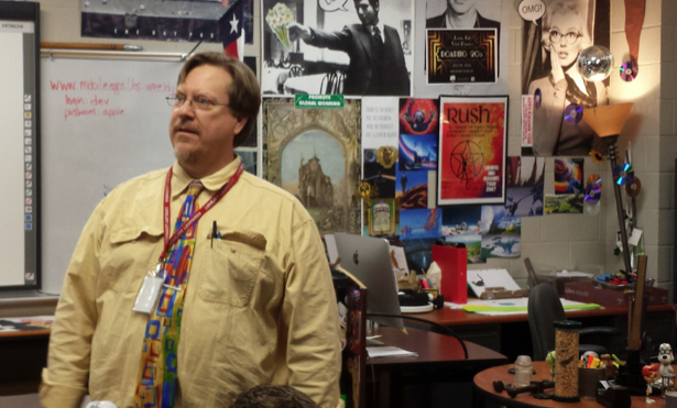 Pre-calculus teacher Andrew Stallings, as an effort by the district to save money, substitutes a class period for digital-media teacher Ray Cooper.
