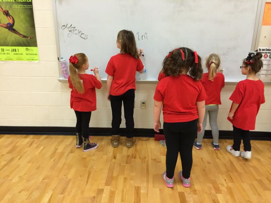 Younger dancers, dubbed mini-Majestics, join the high school team to perform at the February 3rd basketball game.