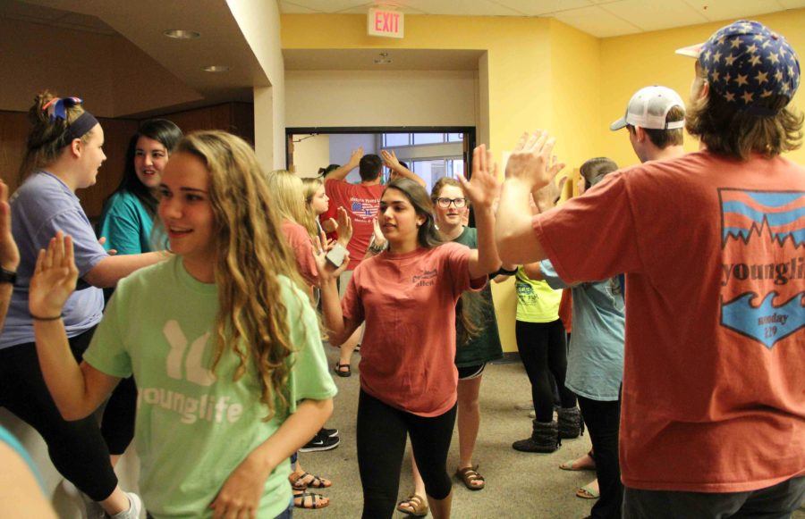 Each Monday night at 7:29, students from the community run through a tunnel of love formed by all area leaders. The high-energy and friendliness of the leaders sets the welcoming and positive tone for the night.