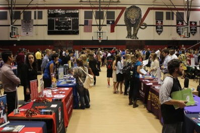 The final college fair of the school year is being held in the main gym with over 50 college representatives attending.