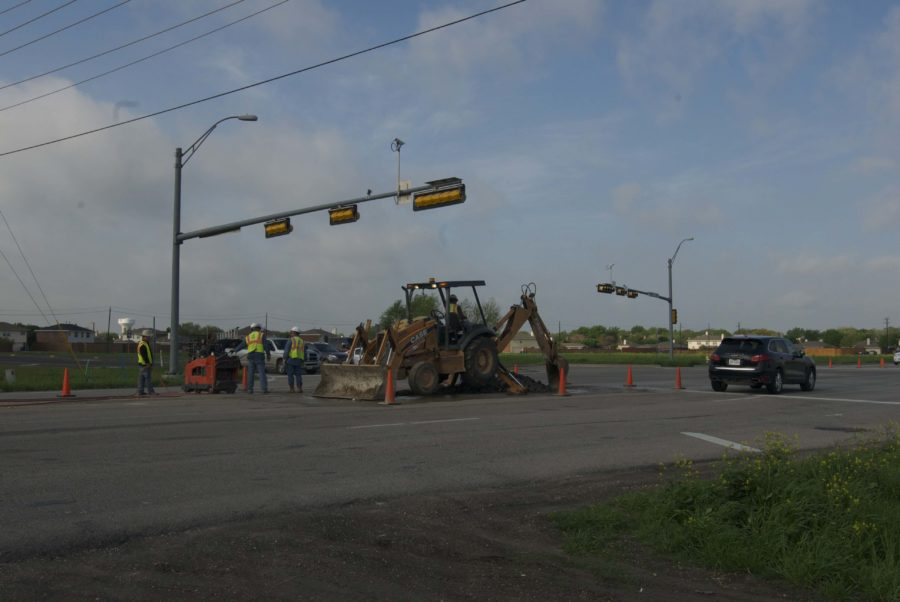 Construction is being done on the raised portion of the road near the intersection of Angel Parkway and Estates Parkway.