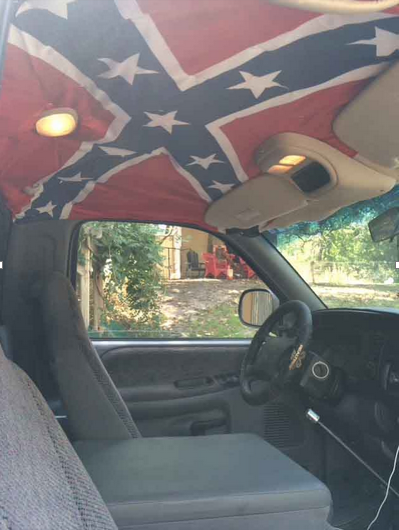 Attached to the interior roof of his truck, junior Josh Shewmake believes the confederate flag is about southern pride and owns several things featuring the Confederate flag.