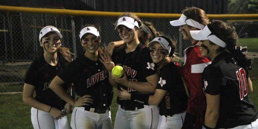 Alyssa+DiFiore+%2813%29+holds+up+the+ball+she+hit+out+of+the+park+as+well+as+four+fingers%2C+for+the+four+runs+she+drove+home+with+it.