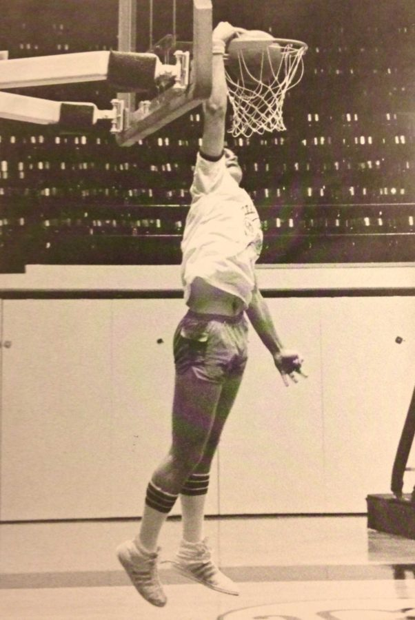 Pre-Calculus teacher, Randy Brooks, dunks a basketball in a high school dunking contest in high school. This photo was featured in his college yearbook.