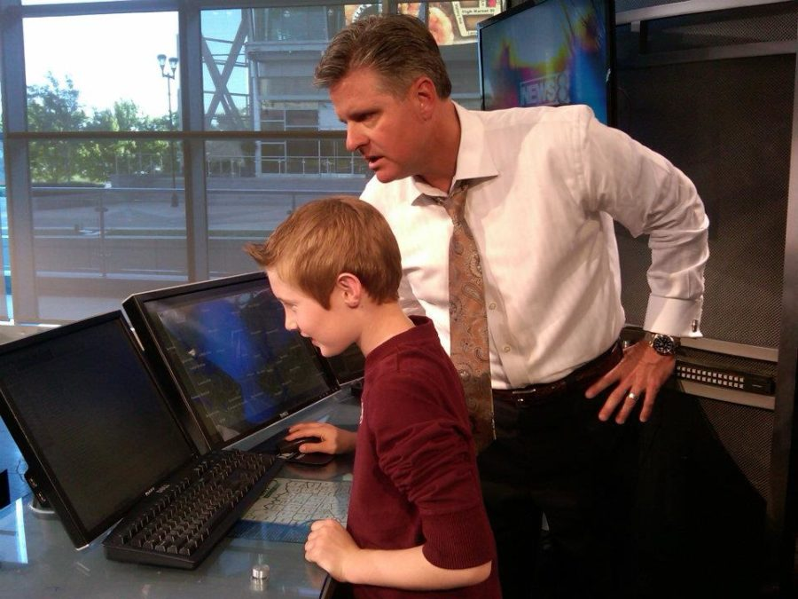 Pete Delkus giving now eighth grader Joe Vastano a tour of the WFAA facilities in 2012.