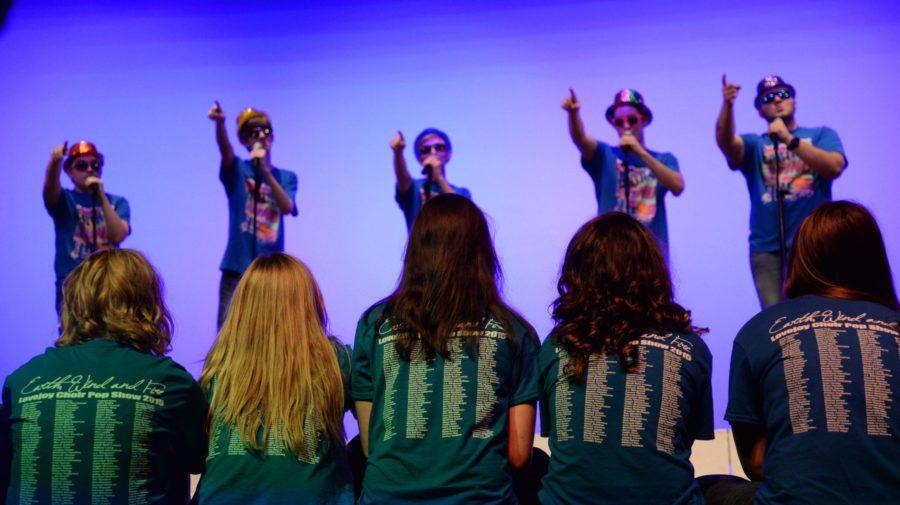 Senior choir boys serenade the senior girls during their Choir Throwback Tribute.