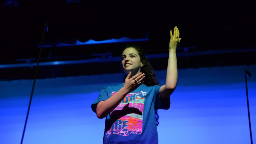 Sophomore Mallory Immel does sign language during her performance of