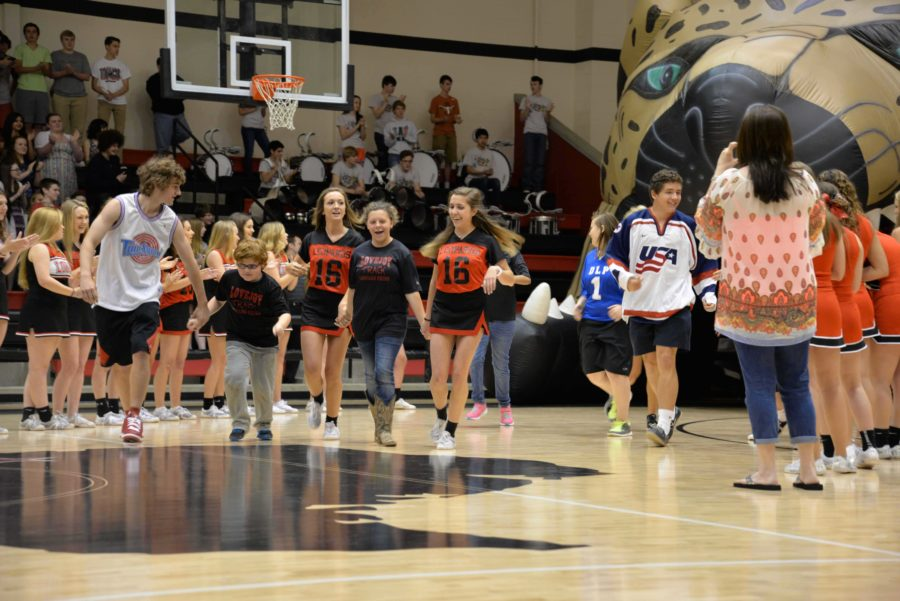PALS, Cheerleaders, and Athletes ran through the leopard head to a roaring applause as Special Olympics season kicks off.
