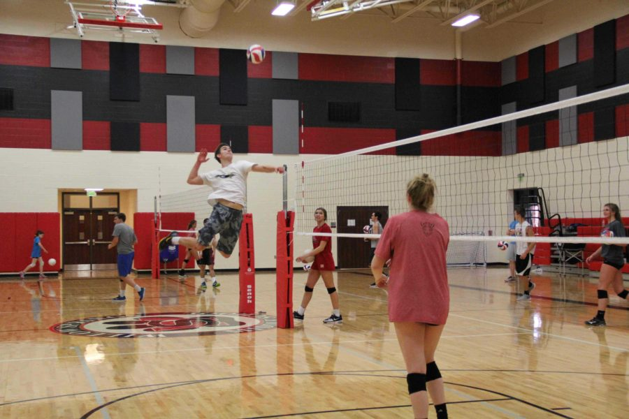 With the help of some Lady Leopard volleyball players, the boys run through a series of drills at every practice to improve  all skills needed for the sport.