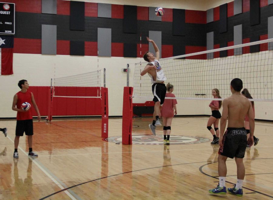 With this time of the year lacking in opportunity for some athletes, most of the team consists of off-season basketball and football players. Shown spiking is varsity basketball player, Eli Traeweek.