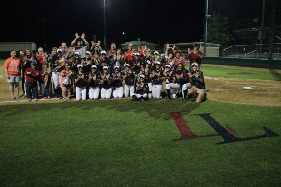 Tonight+was+also+leopard+softball%27s+senior+night.+Pictured+are+the+players+and+the+coaches+posing+with+the+seniors+and+their+parents+following+a+Leopard+win.