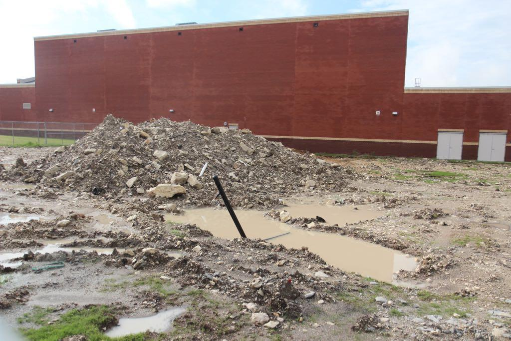 The rain that has removed the five year drought in Texas has put the high school construction zone underwater and requires  manipulating construction plans.
