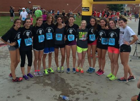Among the more the hundreds of people that took part in the  6th annual Lovejoy Country Run, were numerous members of the school's cross country and track teams.