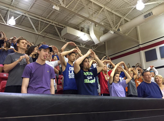 Students participate in the cheer A-O led by the cheerleaders to get pumped up for the Special Olympics pep rally.