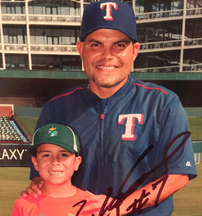 Posing with Texas Rangers baseball legend Ivan Pudge Rodriguez, Lovejoy Elementary second grade student Nicolas Ortega spent some time with Rodriguez at Globe Life Park.
