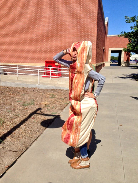 During the first week of school for the 2014-2015 year, Brian Higgins required his editorial staff to wear a bacon suit. Above is Editor-in-Chief Hallie Fischer.