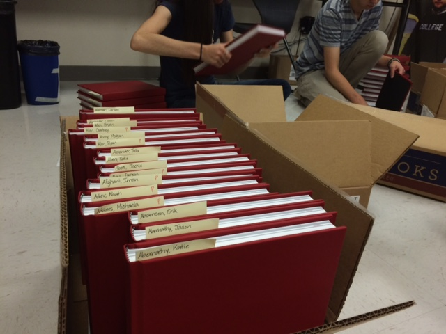 Yearbook students sort yearbooks into boxes for distribution on Tuesday, May 19, 2015.