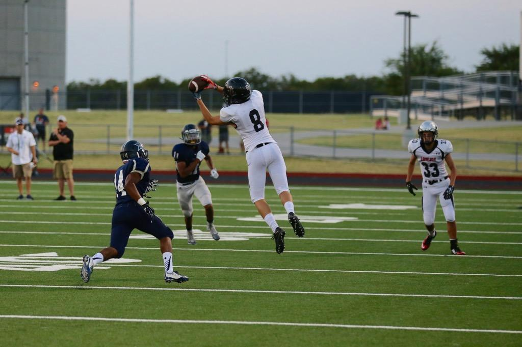 Senior Beau Weiss (8) makes a catch at last week's scrimmage vs. Frisco Lonestar. Football is one of three Leopard sports getting under way this weekend along with volleyball and cross country.