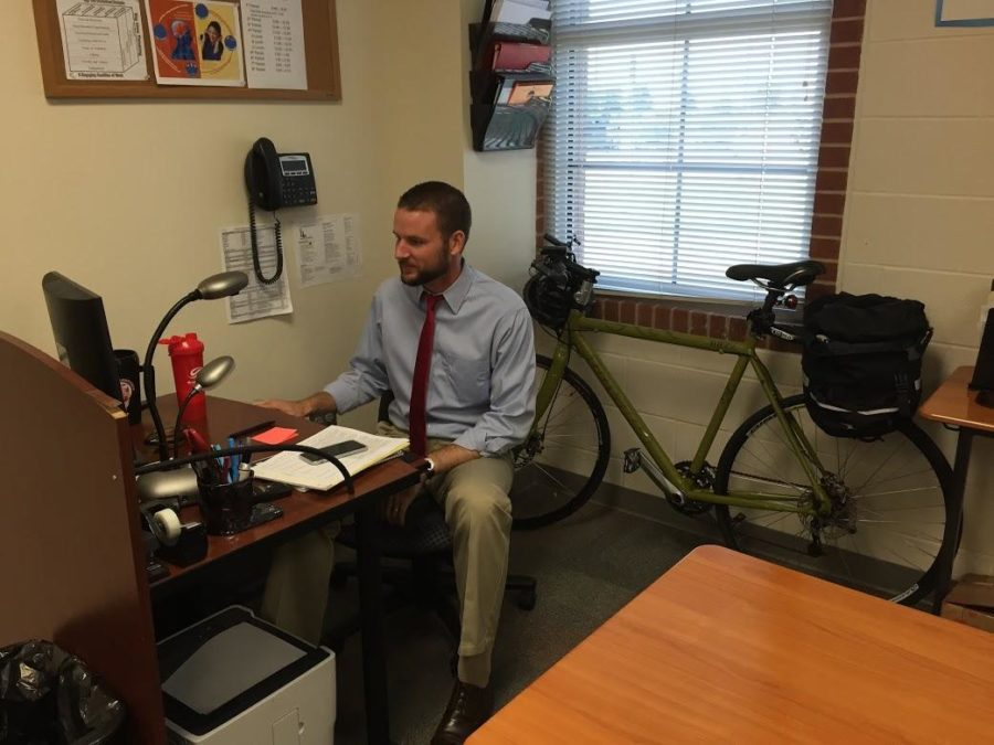 Spanish+teacher+Seth+Sartain+bikes+to+school+every+day.+He+then+stores+his+bike+in+his+classroom+while+he+works.