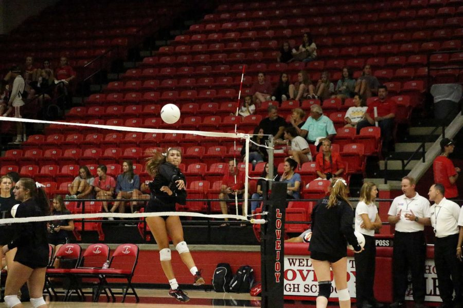 Sophomore Megan Gardner jumps to hit the ball to opposing team, Wylie Pirates.