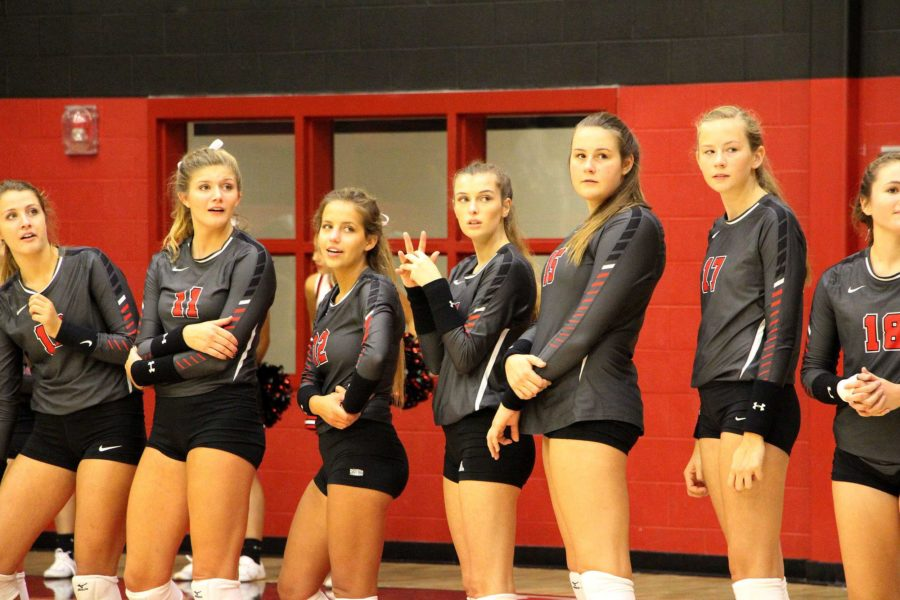 Lady Leopards watch  senior Julia Alexander sing the Star-Spangled banner before the game.