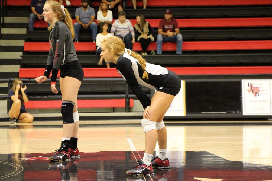 Junior Lexie Smith rests in between serves.