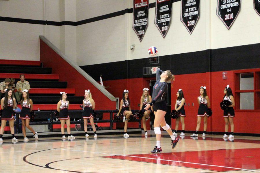 Junior Callie Holden serves first ball of game.
