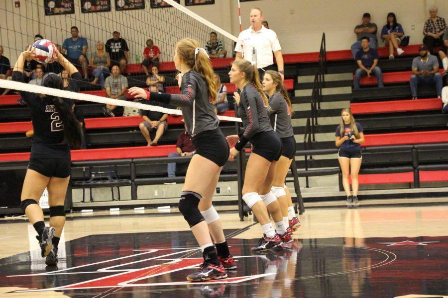 Senior Avery Arellano, Junior Bailey Downing, Junior Lexie Smith all prepare defensively for a strike from Wylie players.