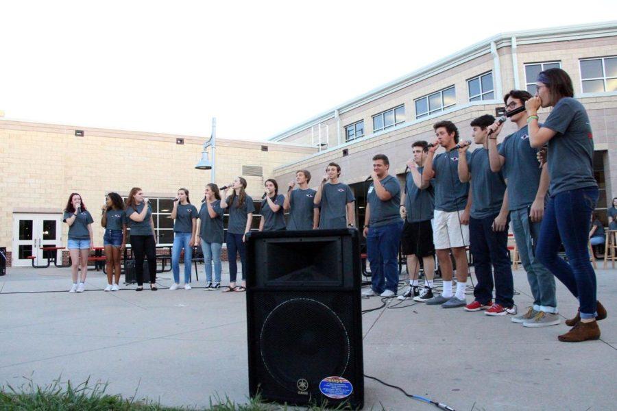 The pop ensemble, A Cappella, sings Under Pressure.