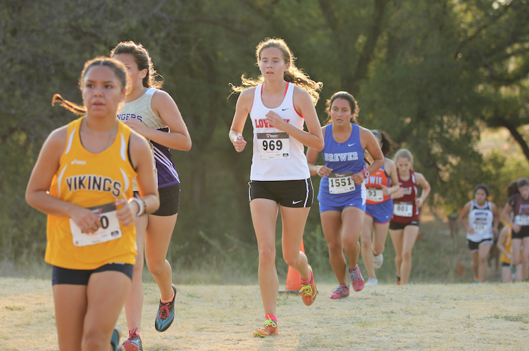 Senior+varsity+runner+Katherine+Powell+maintains+her+speed+after+clearing+a+hill+at+the+Aug.+28+meet.