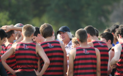 Greg Christensen, head coach, talks to the JV boys in their