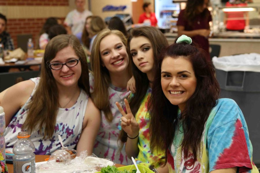 Alison+Nies%2C+Lauren+Willmann%2C+Jenny+Kaya%2C+and+Cayley+Toft+pose+in+their+tie-dye+shirts.
