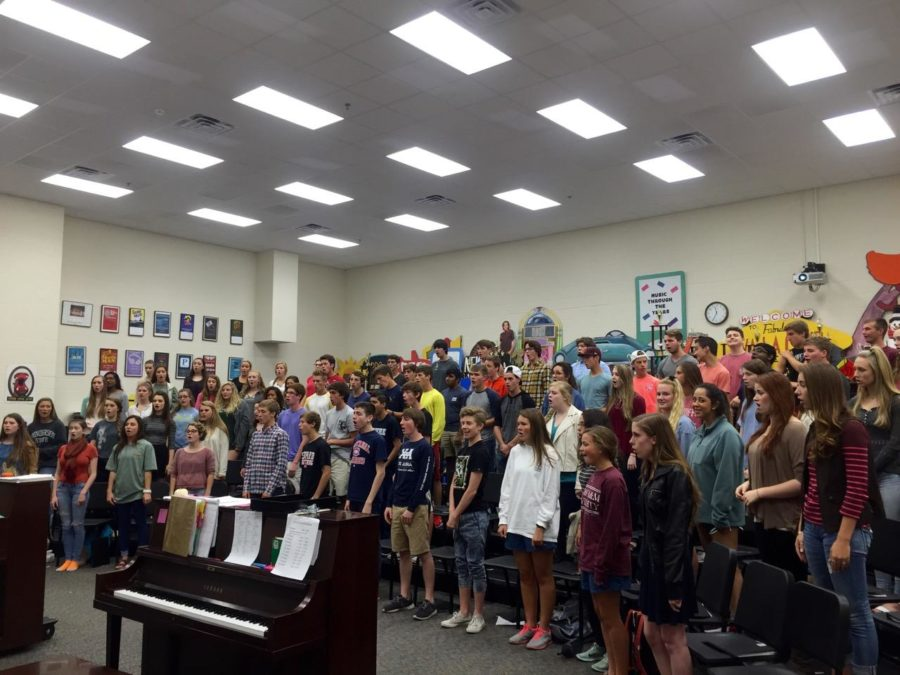 The band has been playing the fight song for years, but now the choir is also joining in on the song. Pictured above is the varsity choir.