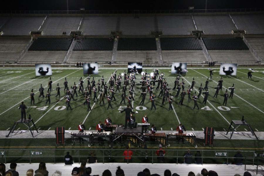 The+woodwinds+and+brass+form+interlocking+blocks+that+slide+alongside+each+other+at+the+UIL+area+competition+in+Mesquite.