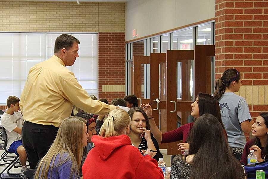 Junior Kioko Jahn samples a piece of sushi during C lunch from director of nutrition Mat McCarty.