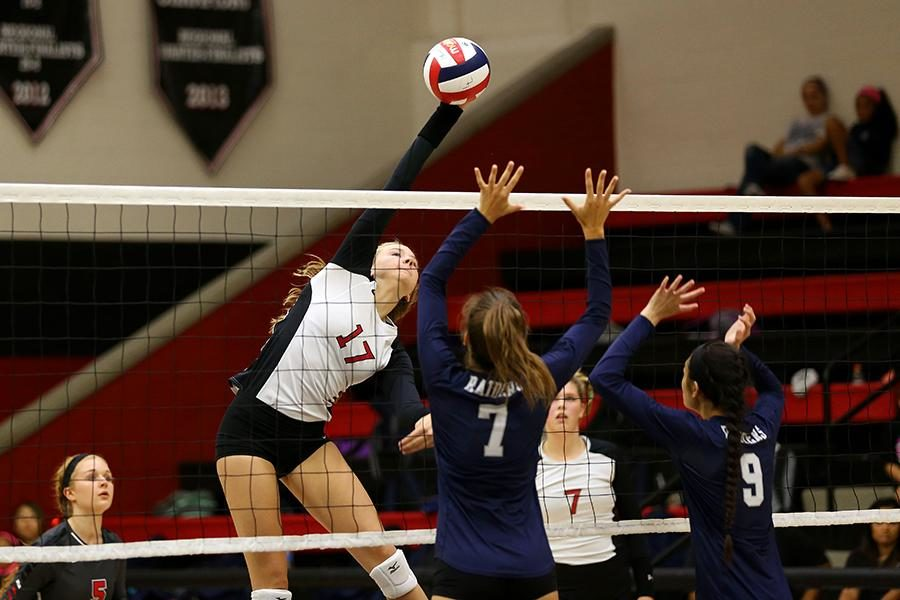 Sophomore Rachel Langs spikes the ball against Wylie East on Tuesday, Sept. 22.