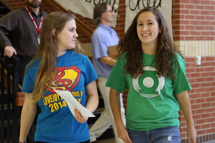 Holly+Thomson+and+Miranda+Perry+walk+through+the+cafeteria+wearing+their+superhero+t-shirts.