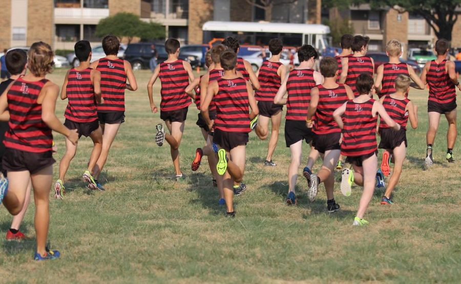 JV+Warms+up+for+a+race+at+Cowtown+Cross+Country+Invitational.