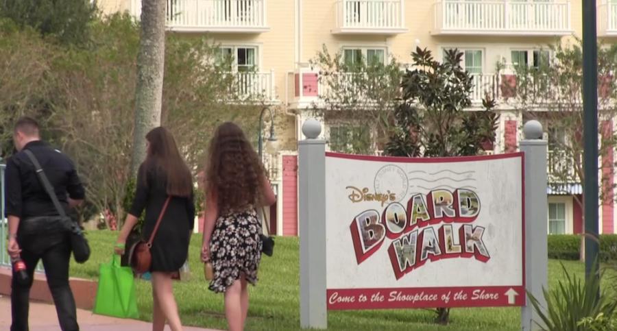 People walk towards the Disney Boardwalk.  The Disney Parks have recreated nearly every major landmark.
